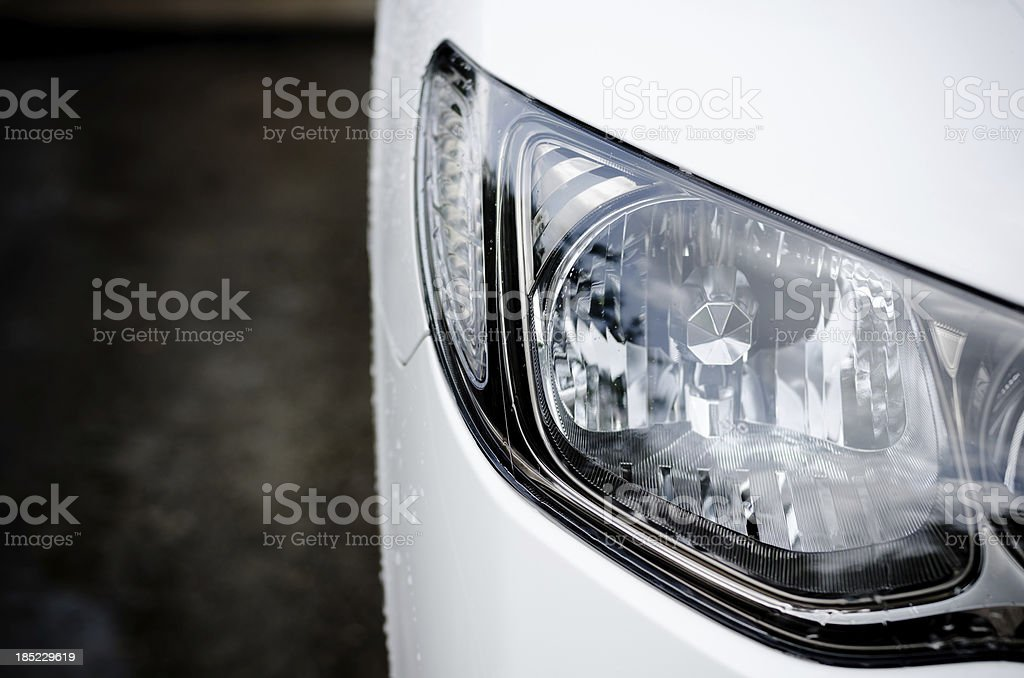 Car head lights in silver stock photo