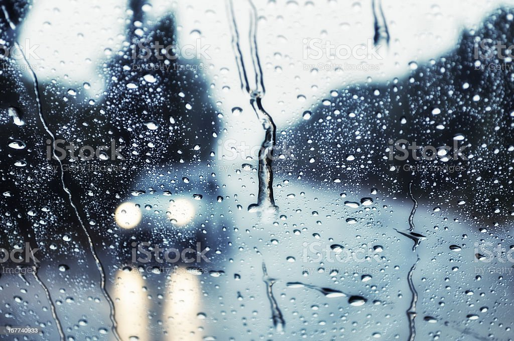 car headilights - driving in heavy rain stock photo