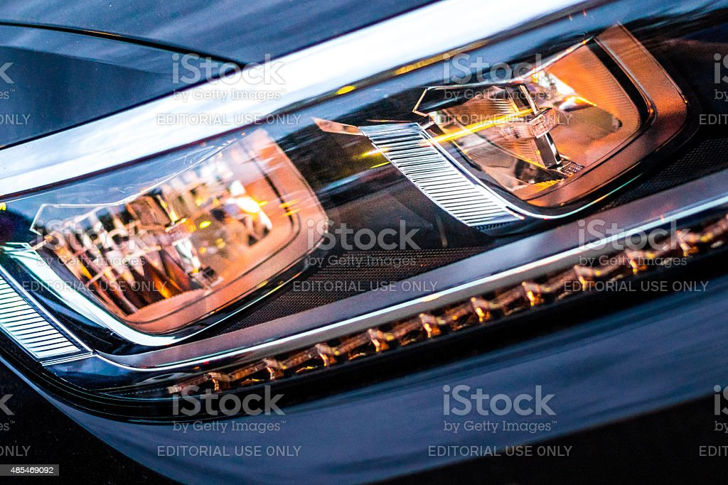 Car headlight  from new black VW vehicle stock photo
