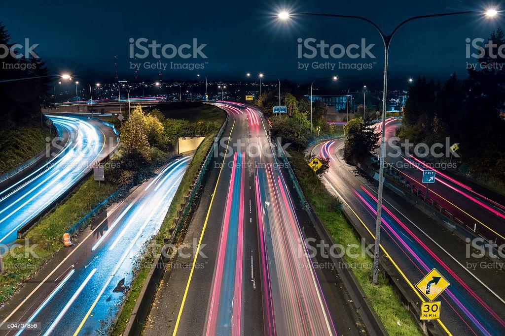 Car Headlight Streaks on Freeway at Night in Seattle stock photo