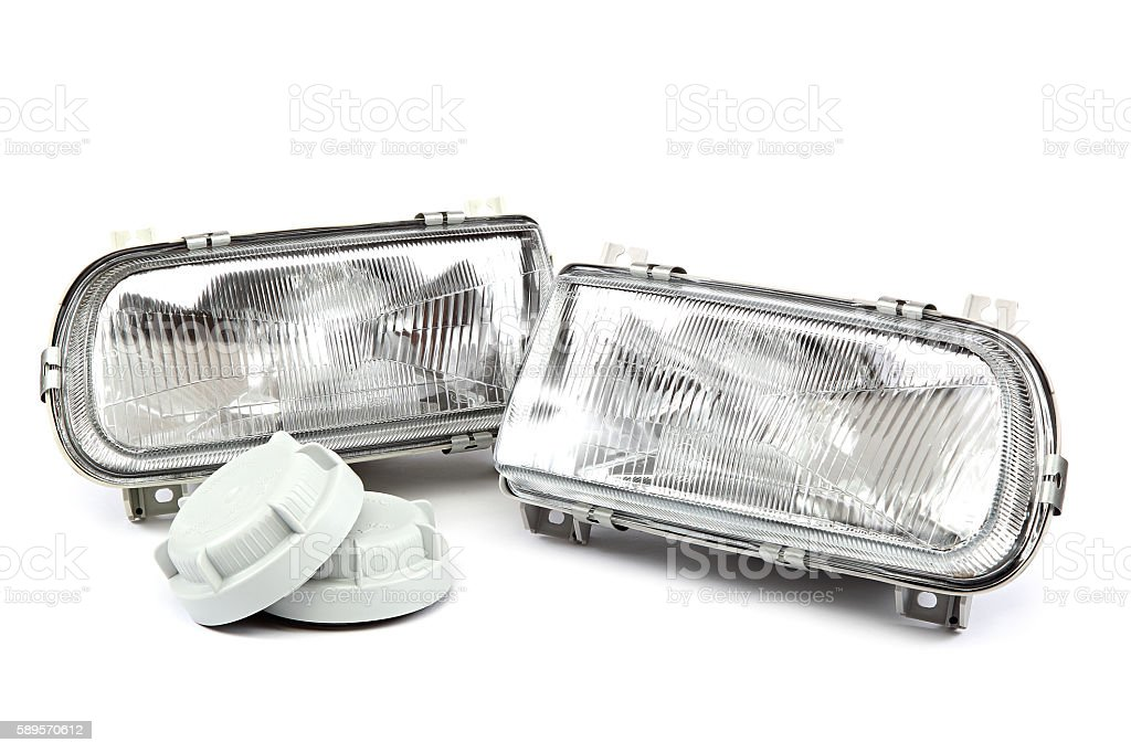 Car headlights isolated on a white background. stock photo