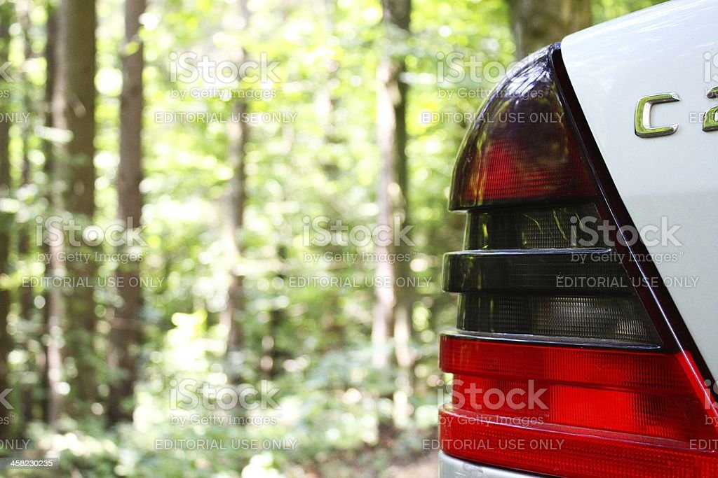 Car in a forest royalty-free stock photo