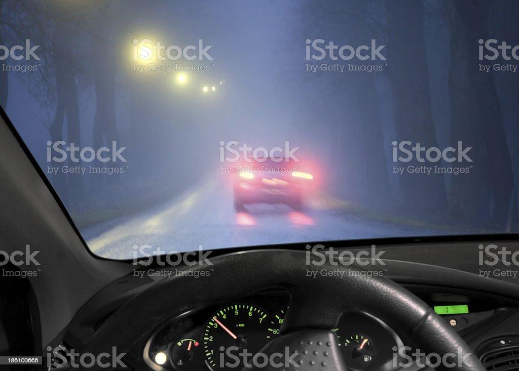 Car in fog stock photo