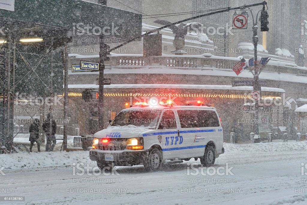NYPD car in Manhattan, NY during massive Winter Snow Storm stock photo