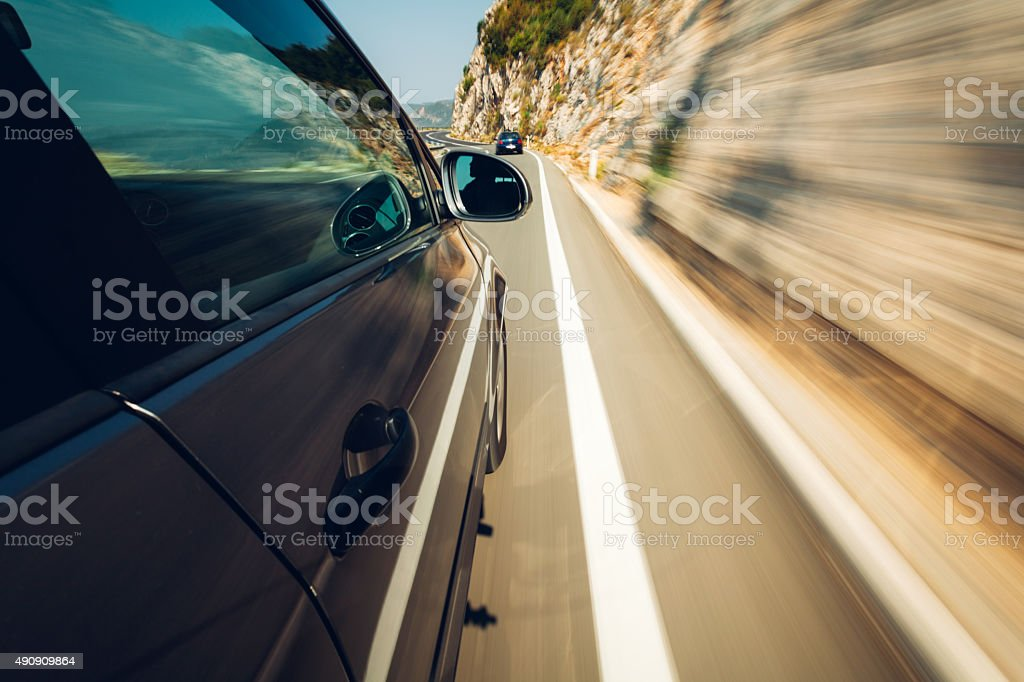 Car in motion on highway stock photo