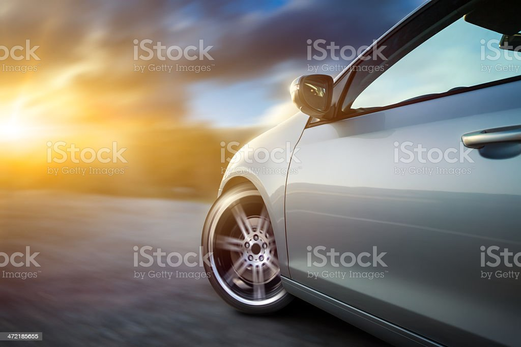Car in motion on sunset stock photo