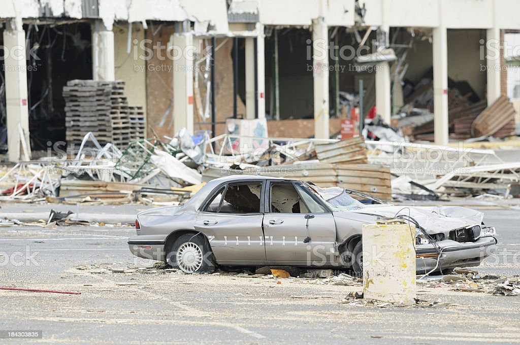 Car in parking lot destroyed by tornado stock photo