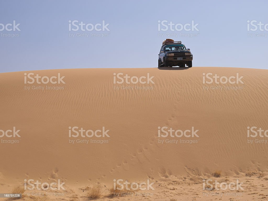 Car in Sand dune stock photo