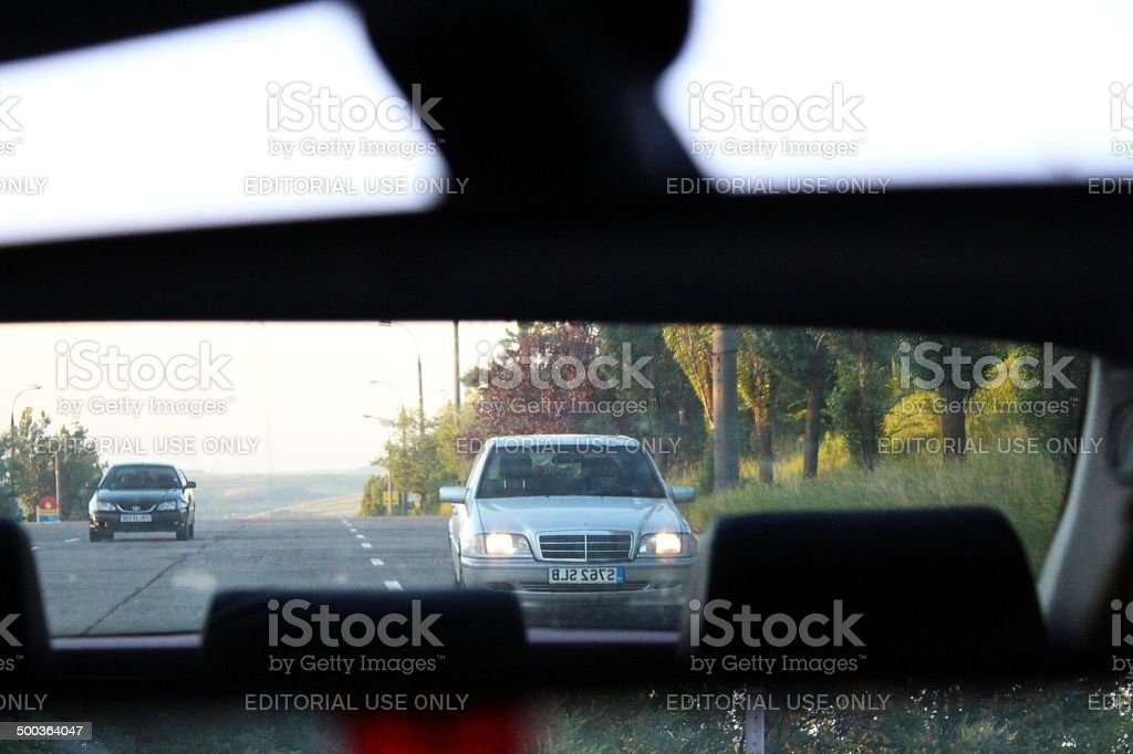 Car in the rear view mirror stock photo