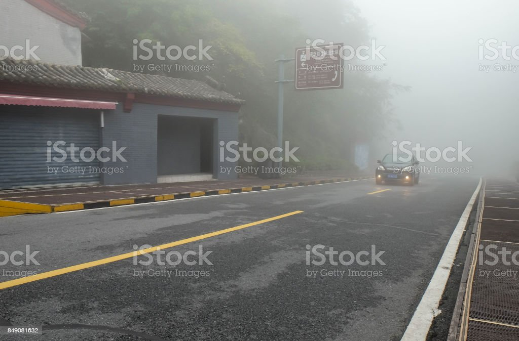 A car in the Wudang mountain and a lot of the mist in here. stock photo