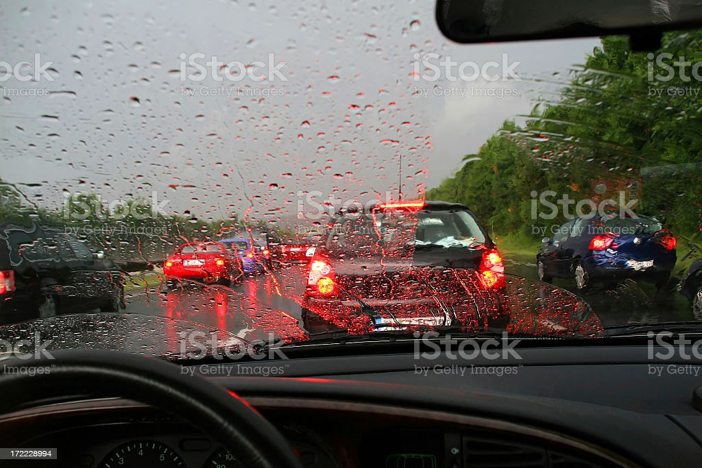 Car in traffic jam with rain covered windshield stock photo