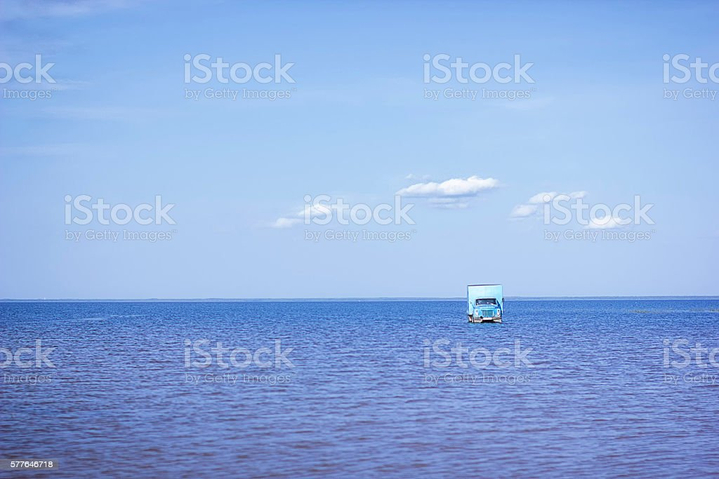 car in water stock photo