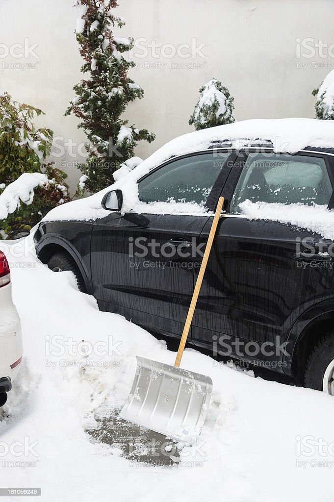 Car in winter with snow shovel stock photo