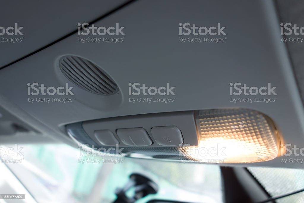 car interior ; close up of cabin lights switch stock photo