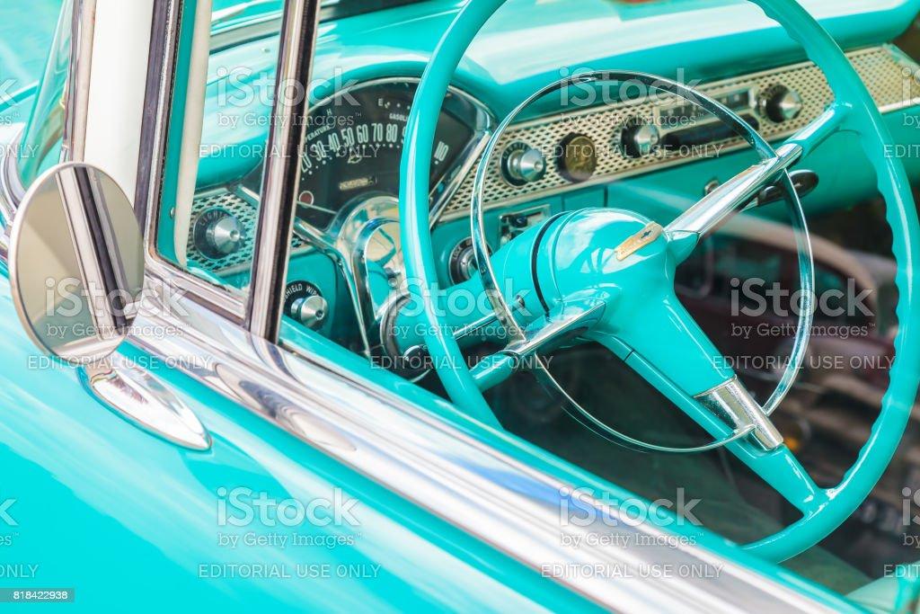 Car interior of a blue fifties Chevrolet car stock photo