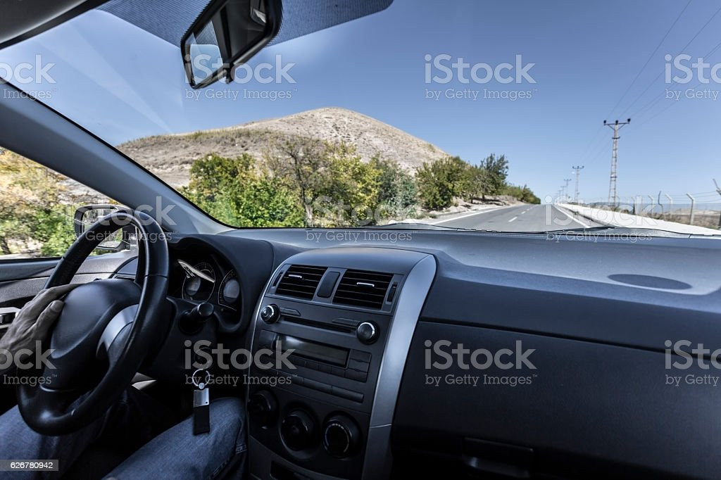 Car interior with driver stock photo