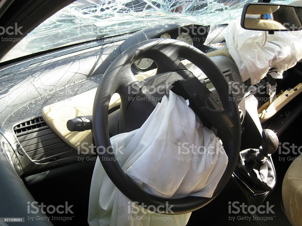 car internal drive crashed airbag exploded and destroyed body stock photo