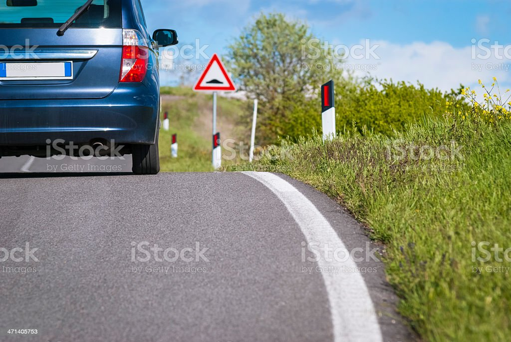 Car is crossing a country road in Tuscany royalty-free stock photo