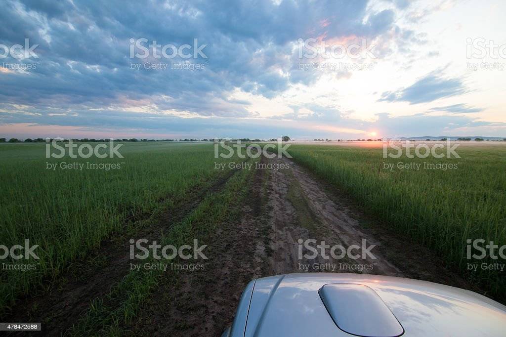 Car is going fishing and meets the sunrise stock photo