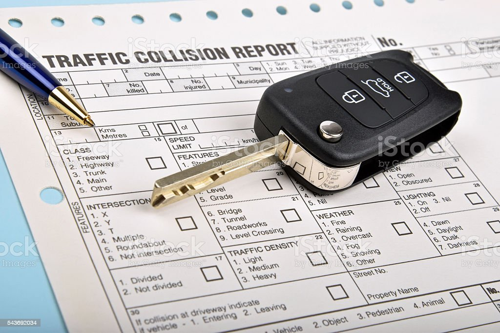 car key and crash report stock photo