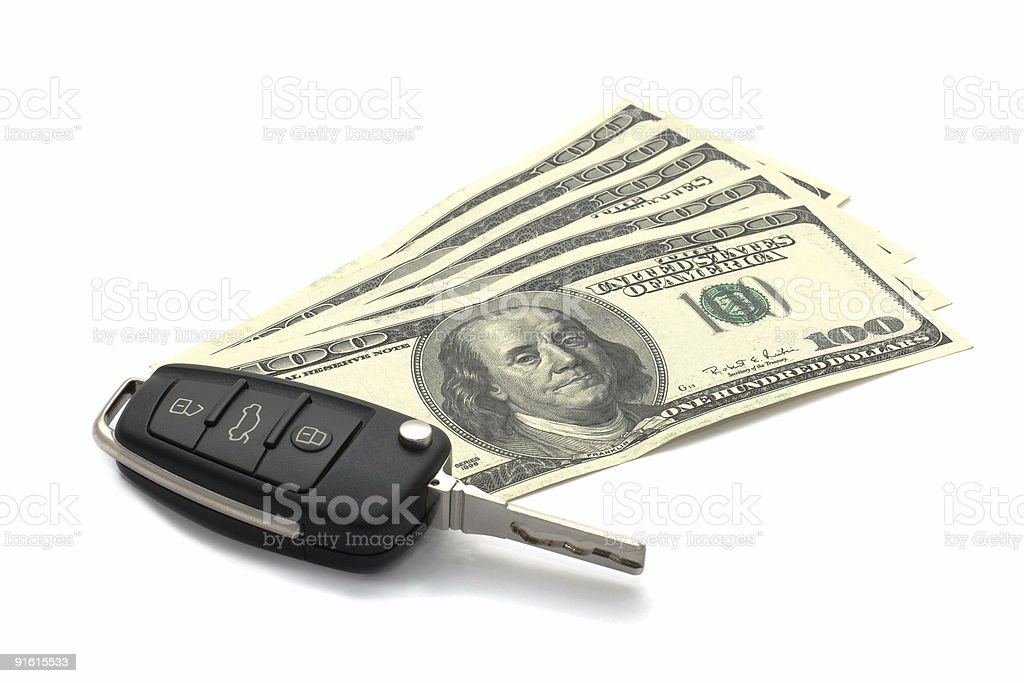 Car Key and Dollars isolated on white. royalty-free stock photo