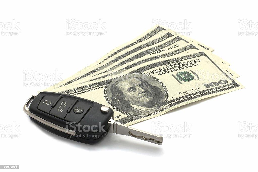 Car Key and Dollars isolated on white. stock photo