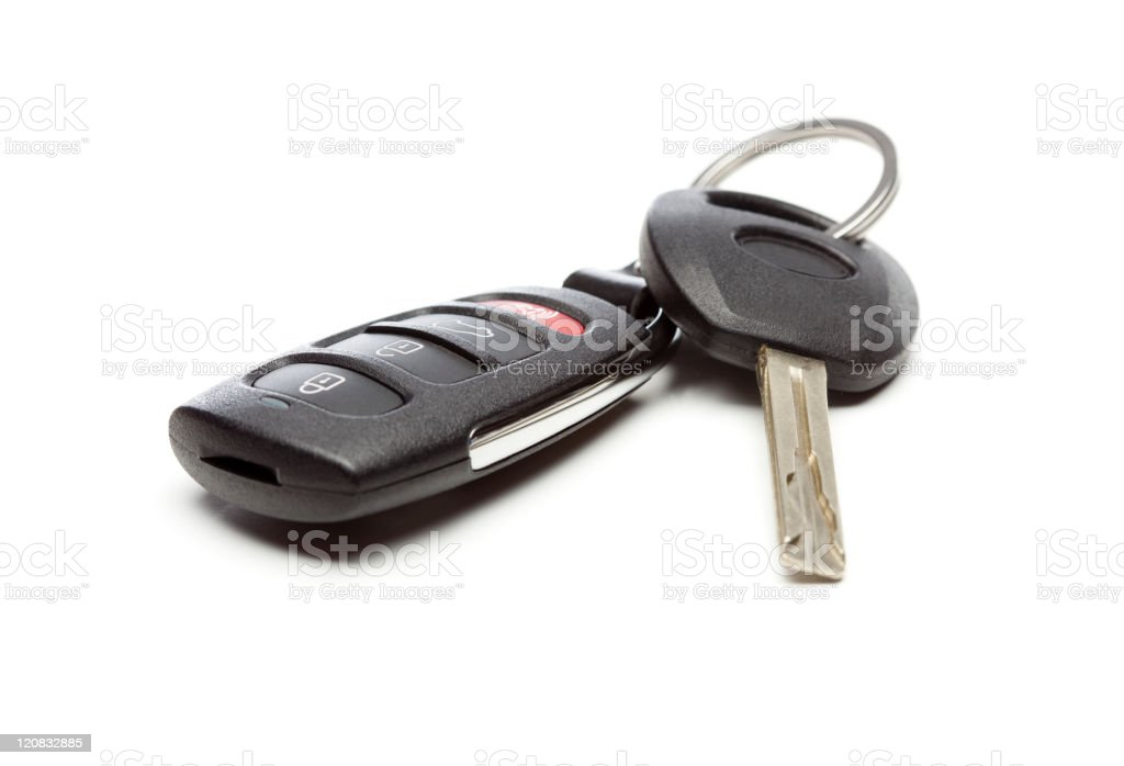 Car key and remote set on white surface royalty-free stock photo