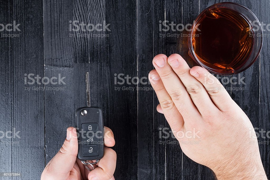 Car key and whiskey alcohol drink in a glass on stock photo
