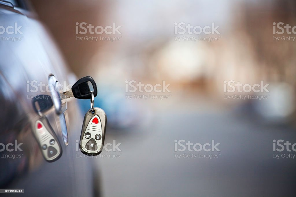Car Key Hanging in Door with Copy Space royalty-free stock photo