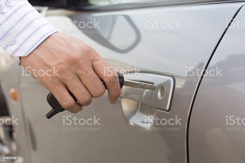 Car key inserted into the lock hole stock photo