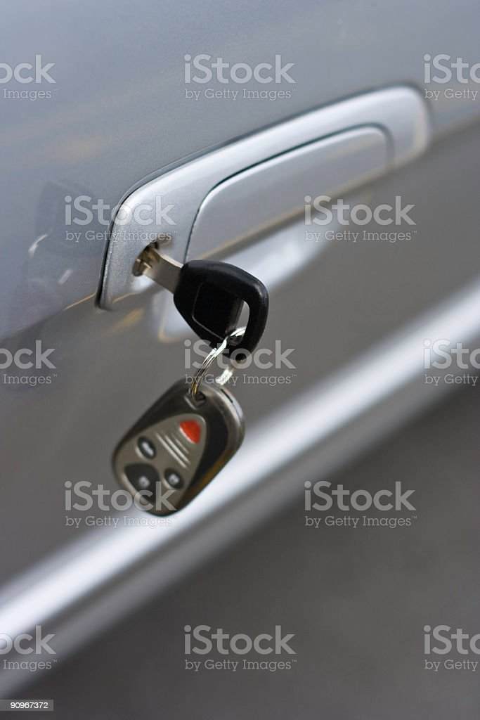 Car Key with Remote Control Hanging in Door royalty-free stock photo