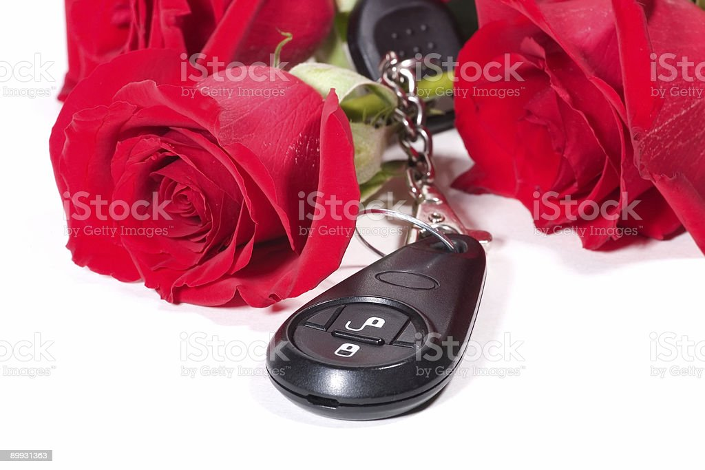 Car keys and roses bouquet present royalty-free stock photo