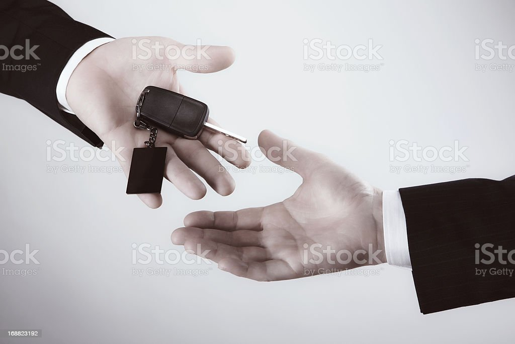 Car keys and two business hands stock photo