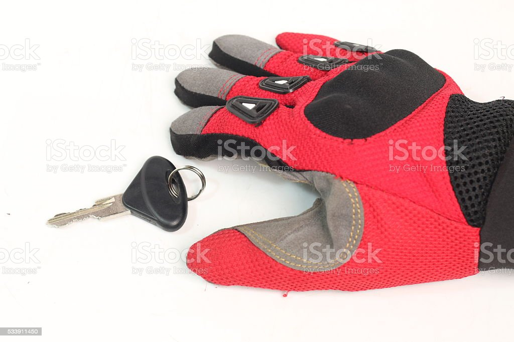Car keys to driving gloves isolated on white background stock photo