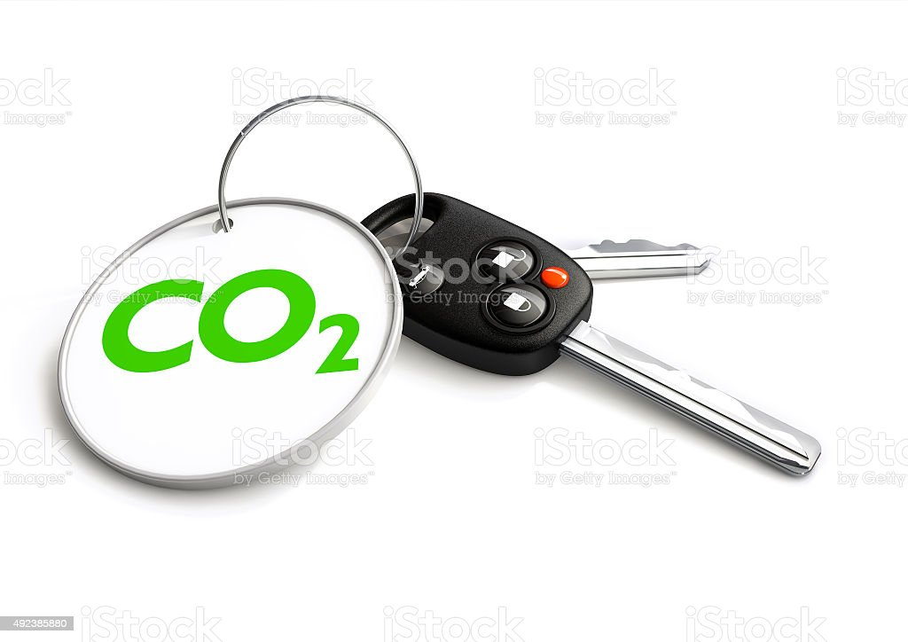 Car keys with co2 carbon emissions symbol on key ring stock photo