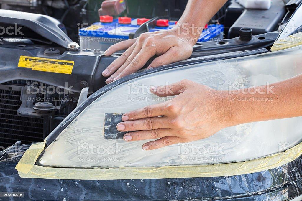 Car lamp polishing stock photo