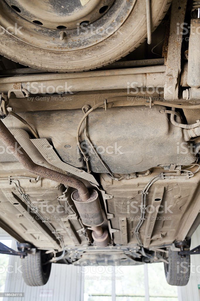 car lifted on auto hoist at repairing station stock photo