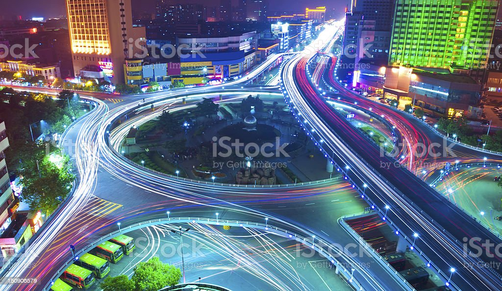 Car light trails in the night city overpass royalty-free stock photo