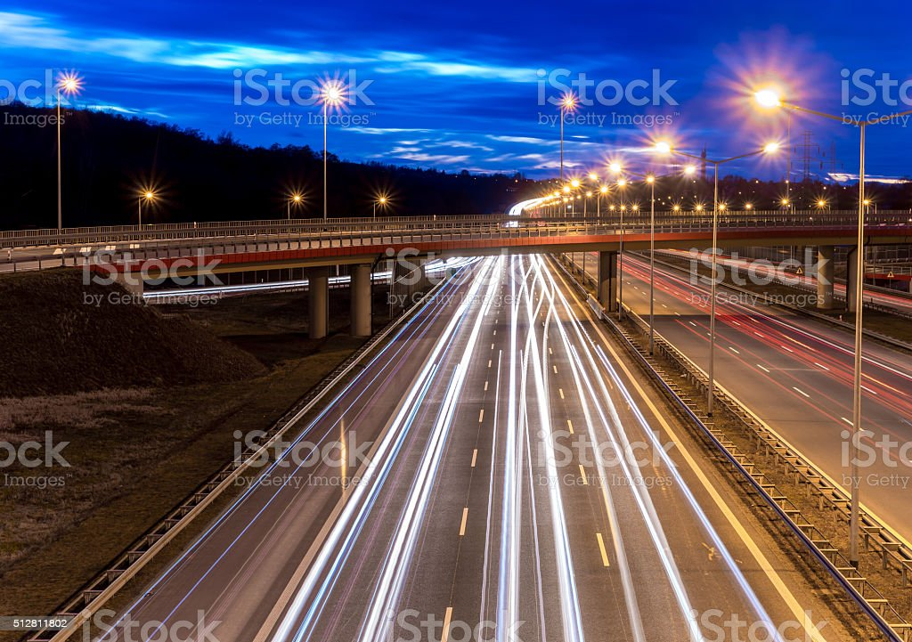 car light trails on motorway junction stock photo