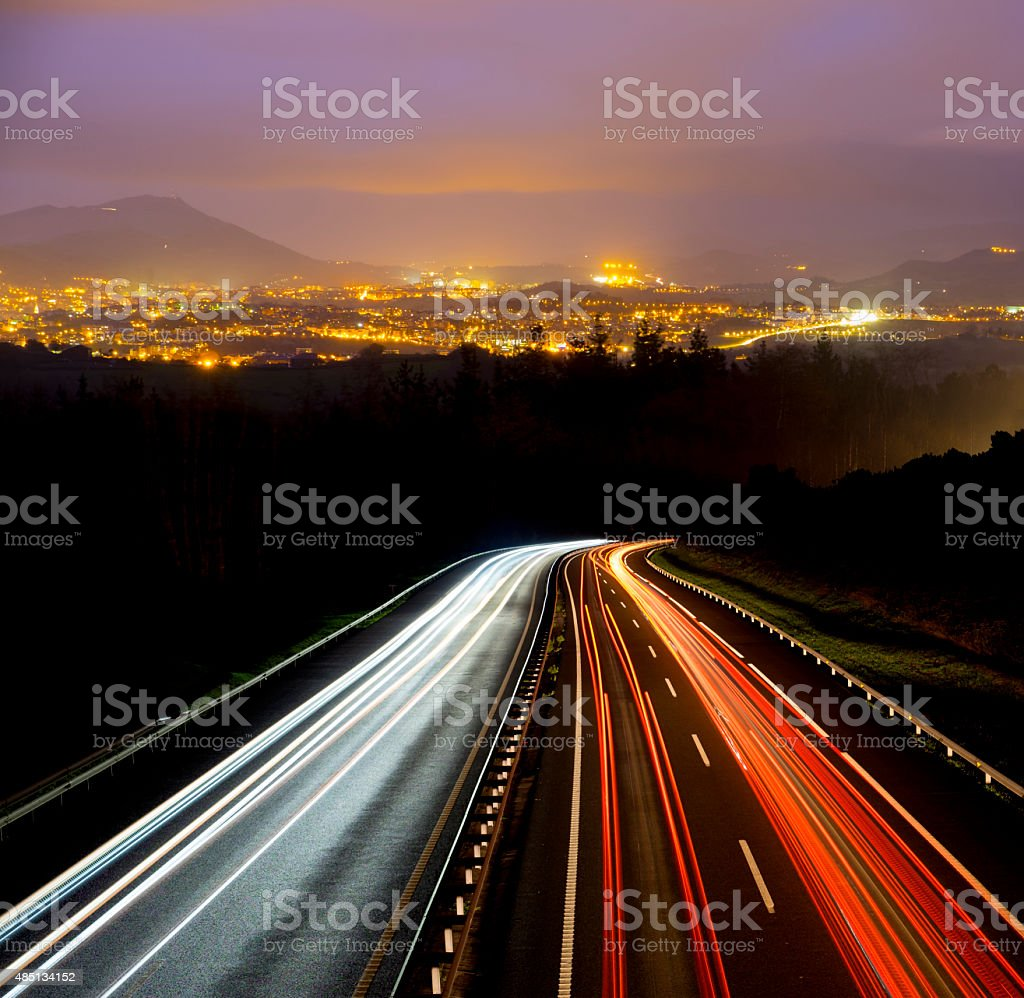 car lights at night going to the city stock photo