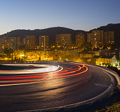 Car lights running on the road at night to city