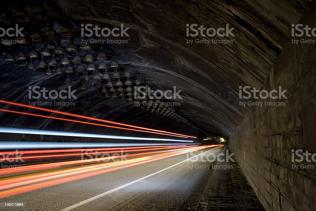 Car lights trails in a tunnel royalty-free stock photo