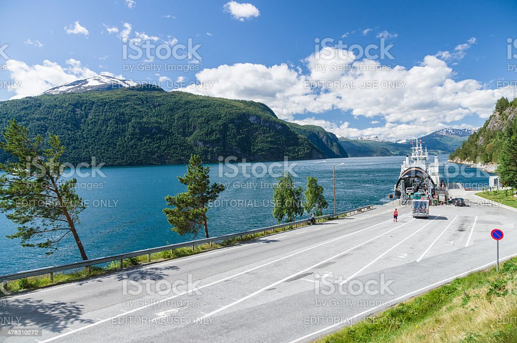 Car loading at small ferry terminal, fjord Norway stock photo