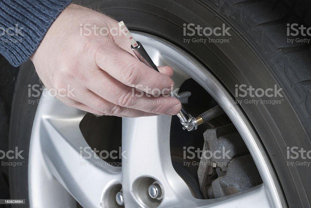 Car Maintenance - Check Tire Air Pressure royalty-free stock photo