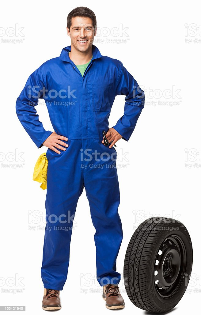 Car Mechanic And Spare Tire- Isolated stock photo