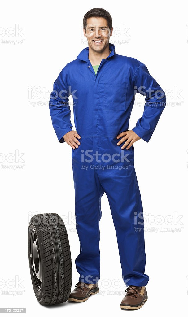 Car Mechanic And Spare Tyre - Isolated royalty-free stock photo