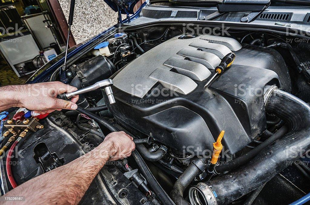 Car mechanic at work stock photo
