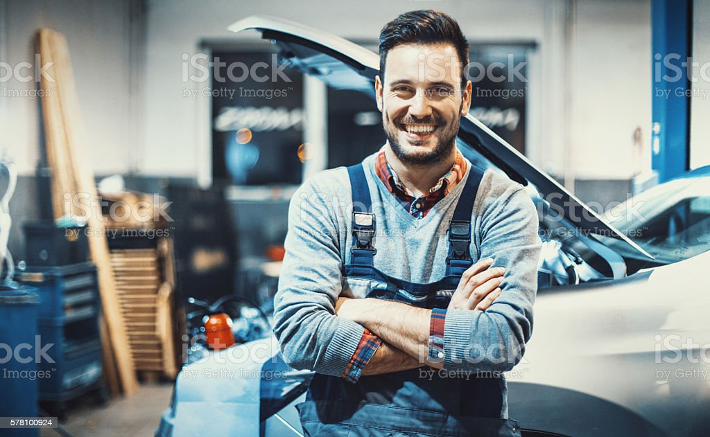 Car mechanic at work. stock photo