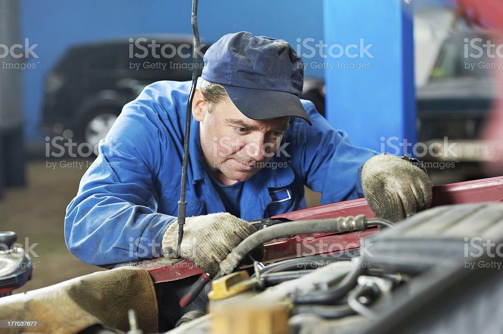 car mechanic diagnosing auto engine problem royalty-free stock photo
