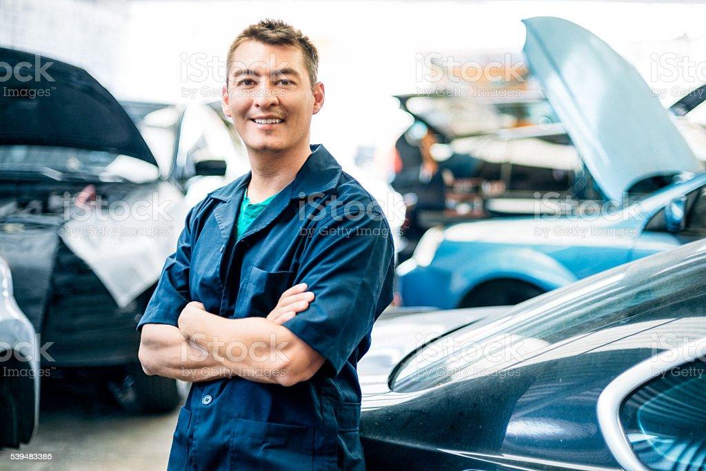 Car mechanic in auto repair shop stock photo